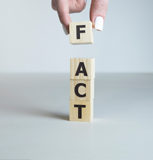 FACT spelled with wooden blocks