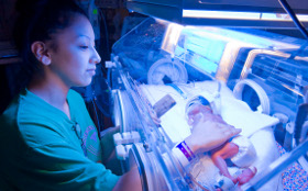 NICU nurse and infant, Newborn Medicine, Floating Hospital for Children