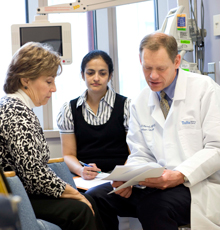 An oncologist and his patient at Tufts Medical Center in Boston.
