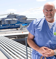 Reuben Rabinovici, MD and the MedFlight helicopter at Tufts Medical Center in Boston.