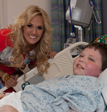 Carrie Underwood visiting a patient at Floating Hospital for Children in Boston.