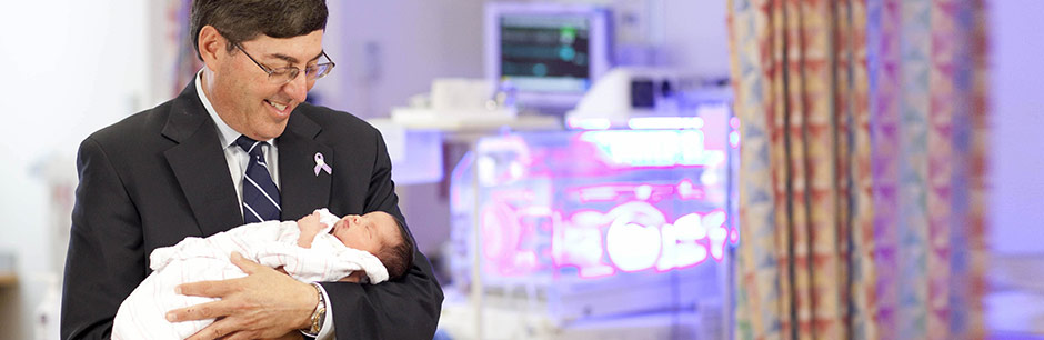 Jonathan Davis, MD and a newborn baby in the NICU at Tufts Medical Center in Boston.